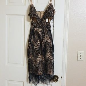 Lace black and nude dress